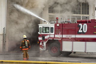 Firefighters put out fire aboard Naval Station Norfolk. | by Official U.S. Navy Imagery