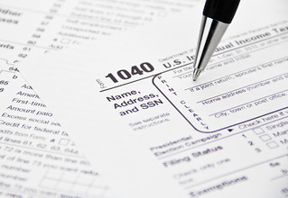 IRS 1040 Tax Form Being Filled Out | by kenteegardin