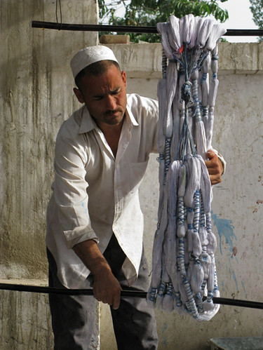 Uyghur man twisting silk to remove excess water - Hotan | by retrotraveller