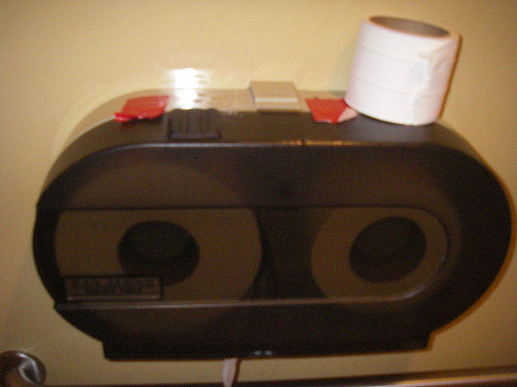 Duct tape on toilet paper dispenser 20091106 | tofightfortheright