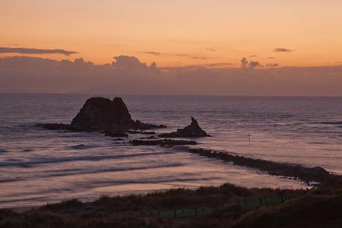 newzealand cloud sun beach water sunrise northland nzl sentinelrock mangawhaiheads