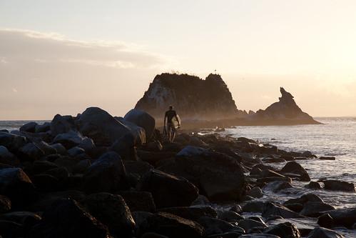 newzealand cloud sun beach water sunrise surfer surfboard northland nzl sentinelrock mangawhaiheads