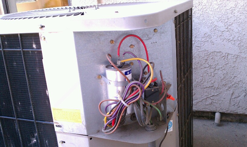 Apco Appliance And Air Working On An Air Conditioner In Co