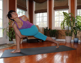 farnoosh brock in an angle bound yoga pose  this is what