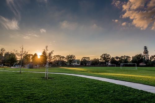 luttigpark trees sidewalk sunset recreation ca outdoor sky park elkgrove evening california clouds unitedstates us