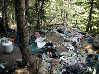 A small portion of the garbage and debris left in the forest at a drug trafficking organization's marijuana grow site on the Shasta-Trinity National Forest in California