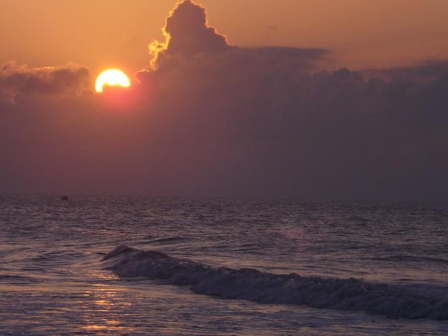Sunrise and waves.