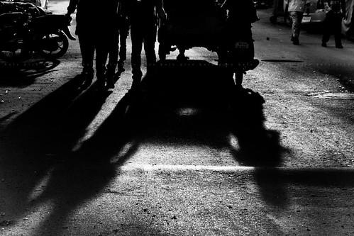 auto life road street morning light shadow people blackandwhite bw sunlight india men monochrome bike sunrise canon blackwhite walk streetphotography vehicles chennai colorless lightandshadow tamilnadu threewheeler cwc twowheeler lightandlife saidapet 550d singarachennai kalspics 18135mmis chennaiweelendclickers fabulouschennai