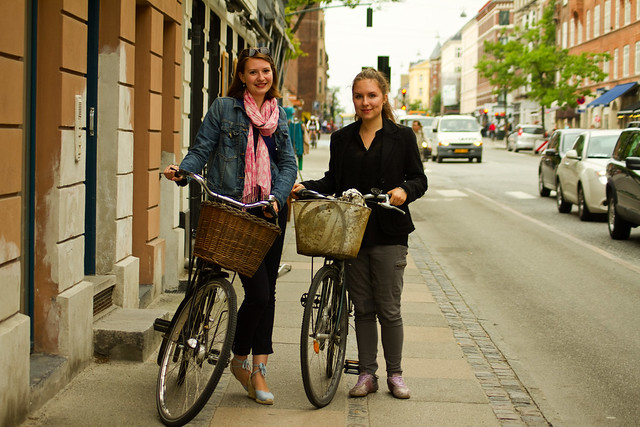 Two Girls With Bicycles
