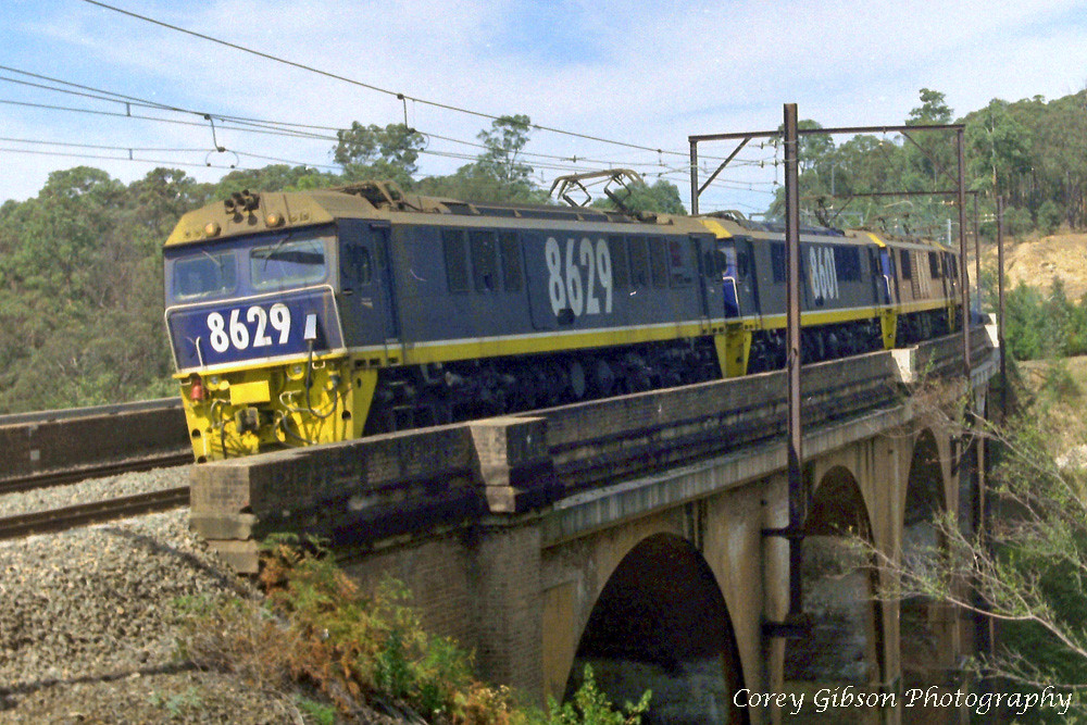 NSW Electric locomotive 8629 with a loaded coal train in the Blue Mountains by Corey Gibson