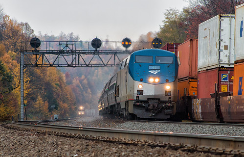 amtrak norfolk southern ns amtk pennsylvanian pennsylvania pittsburgh line prr position lights action passenger train trains meet three fall color cloudy day ge p42dc lilly intermodal freight locomotive