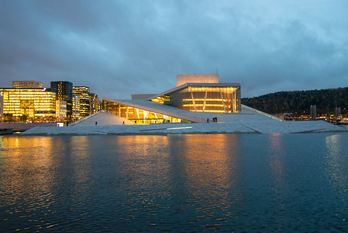 People walking up the Oslo Opera House slopped roof | by Jorge Lascar