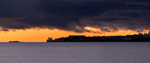 borre esso exxonoilrefinery horten slagentangen steinbrygga blue darkclouds inbetween oilrefinery oljeraffineri orange ship sunrise tanker vessel visualmagic vestfold norway panorama panoramicphoto