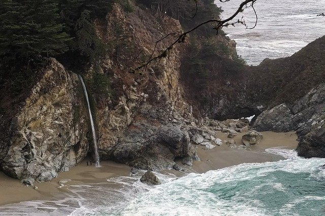 Surfers at McWay Falls, Big Sur