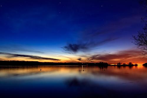 blue light sunset orange sun water river shore danube sabinfotaro