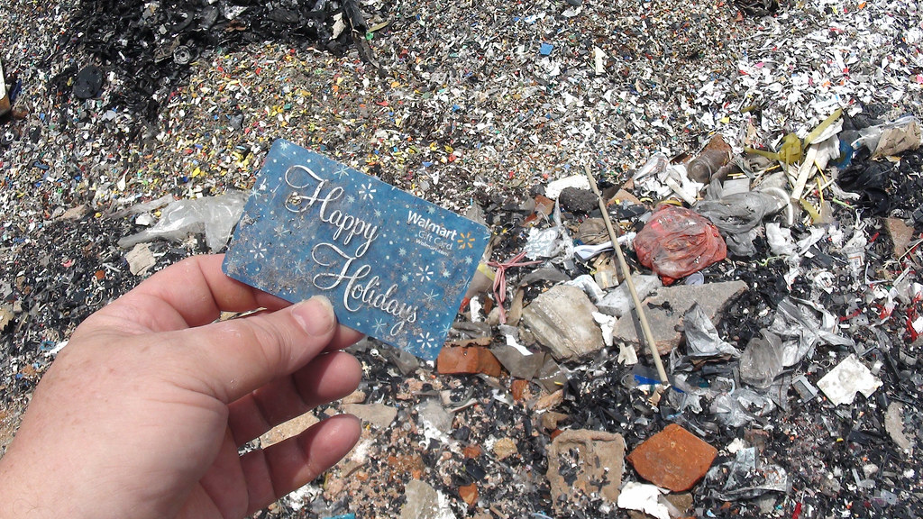photo of a gift card in plastic garbage