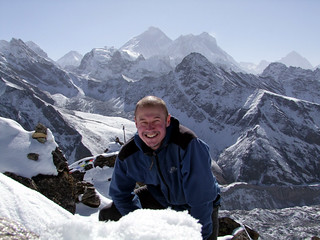 Me on the summit of Gokyo Ri (5360m) with Everest and Lhotse behind me | by markhorrell