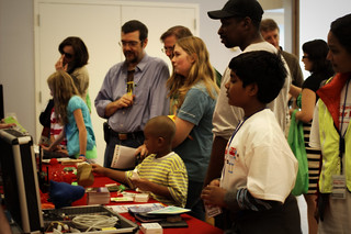 crowd of people at HacDC's maker faire table