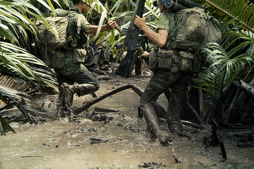 Vietnam War 1968 - Armed South Vietnamese marines slog through jungle mud, Mekong Delta, South Vietnam - by Wilbur E Garrett
