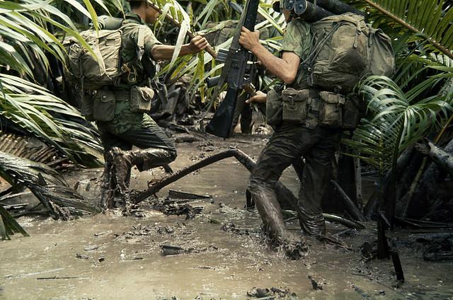 Vietnam War 1968 - Armed South Vietnamese marines slog through jungle mud, Mekong Delta, South Vietnam - by Wilbur E Garrett