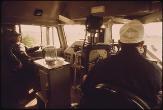 Fireman, left, and engineer in the cab of the Empire Builder passenger train as it heads west from Chicago to East Glacier Park Montana, and Seattle, Washington, June 1974