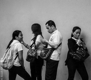Manila, Mega Mall Staff checking missied calls and messages on their cell phones as soon as their shift ends....... | by Sivesh Kumar
