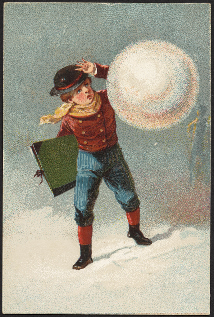 Boy holding a book about to be hit with a snowball. [front]