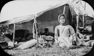 First Nations girl in front of a tent / Fille des Premières Nations devant une tente