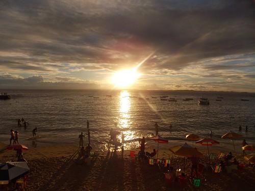 sunset sky people cloud sun beach clouds boats boat sand