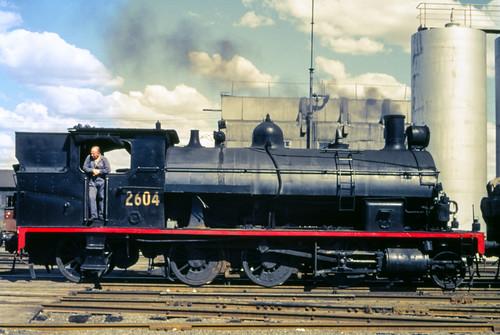 people film industrial transport tracks australia slide trains scan steam nsw aus railways bathurst filmscan 2604 35mmfilmcamera yashicaj3 35mmslrcamera yashinon50mmf2lens canonpixmamg8150 hanimexcs50 rpaunsw26class railpage:class=180 railpage:loco=2604 rpaunsw26class2604