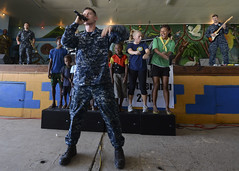 Members of the U.S. Pacific Fleet Band perform for students at the Kokopo Secondary School.