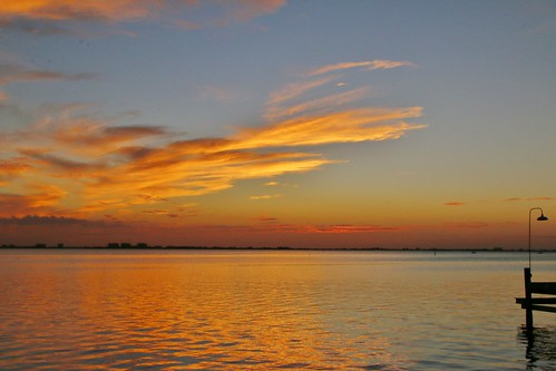 blues orange yellow red reflections docklight clouds sarasotabay calm sunset colors