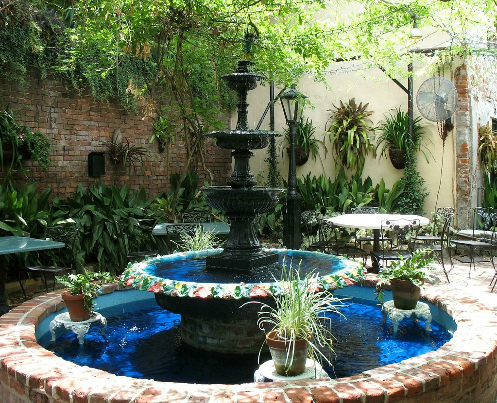 The Devil's Wishing Well, surrounded by ornamental plants.