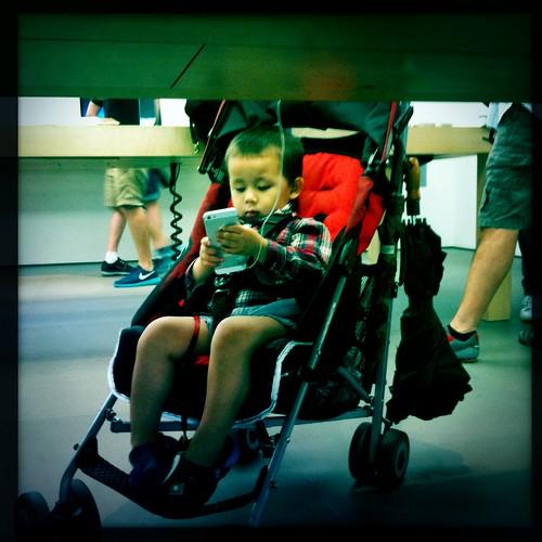 My nephew at the Apple Store, Soho