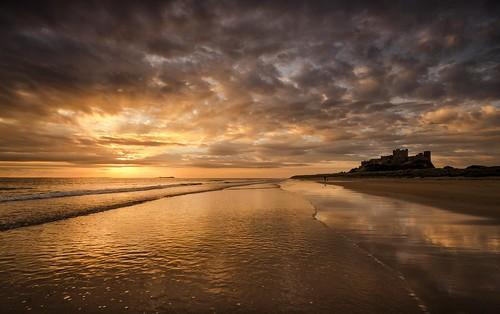 bamburghcastle bamburgh northumberland northeast beach castle sunrise sunrays onemanandhisdog walking reflections moody moods reflects nikond7000 sigma1020mmf4