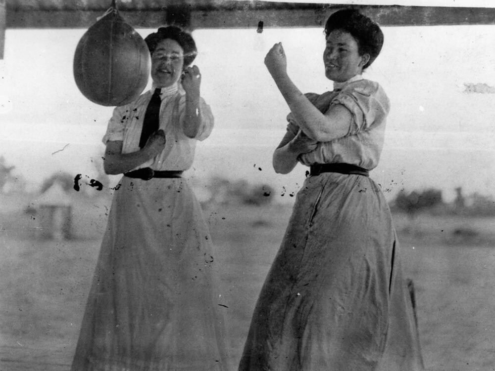 Durack sisters sparring with a speed bag