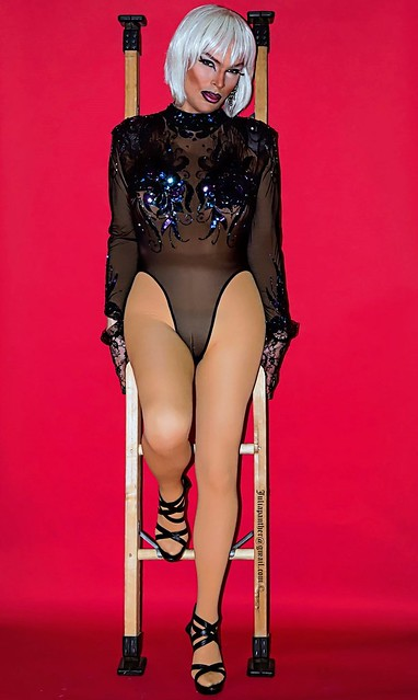 Glamour look in sheer bodysuit and pantyhose
