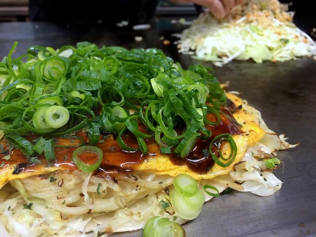 Okonomiyaki topped with sliced spring onion from Carp @ Kanda