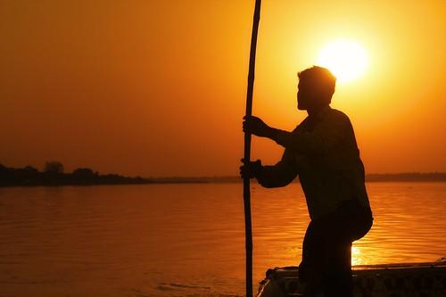travel sunset india silhouette river evening boat peace crossing indian documentary peaceful tranquility traveller serenity serene passage boatman ruralindia centralindia madyhapradesh