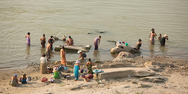 Burmese people wash in the Irrawaddy river