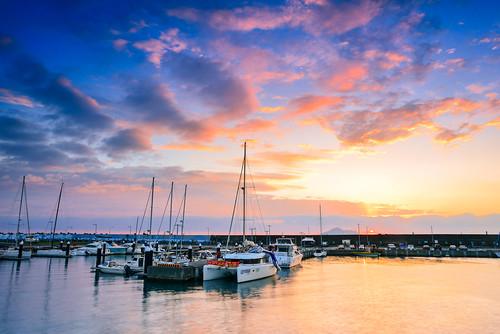 taiwan ilan wushiport sunrise dawn boat cloud reflection sky sailboat sun scenery outdoors 台灣 宜蘭 烏石港 帆船 火燒雲 天空 晨曦 雲彩 頭城 toucheng