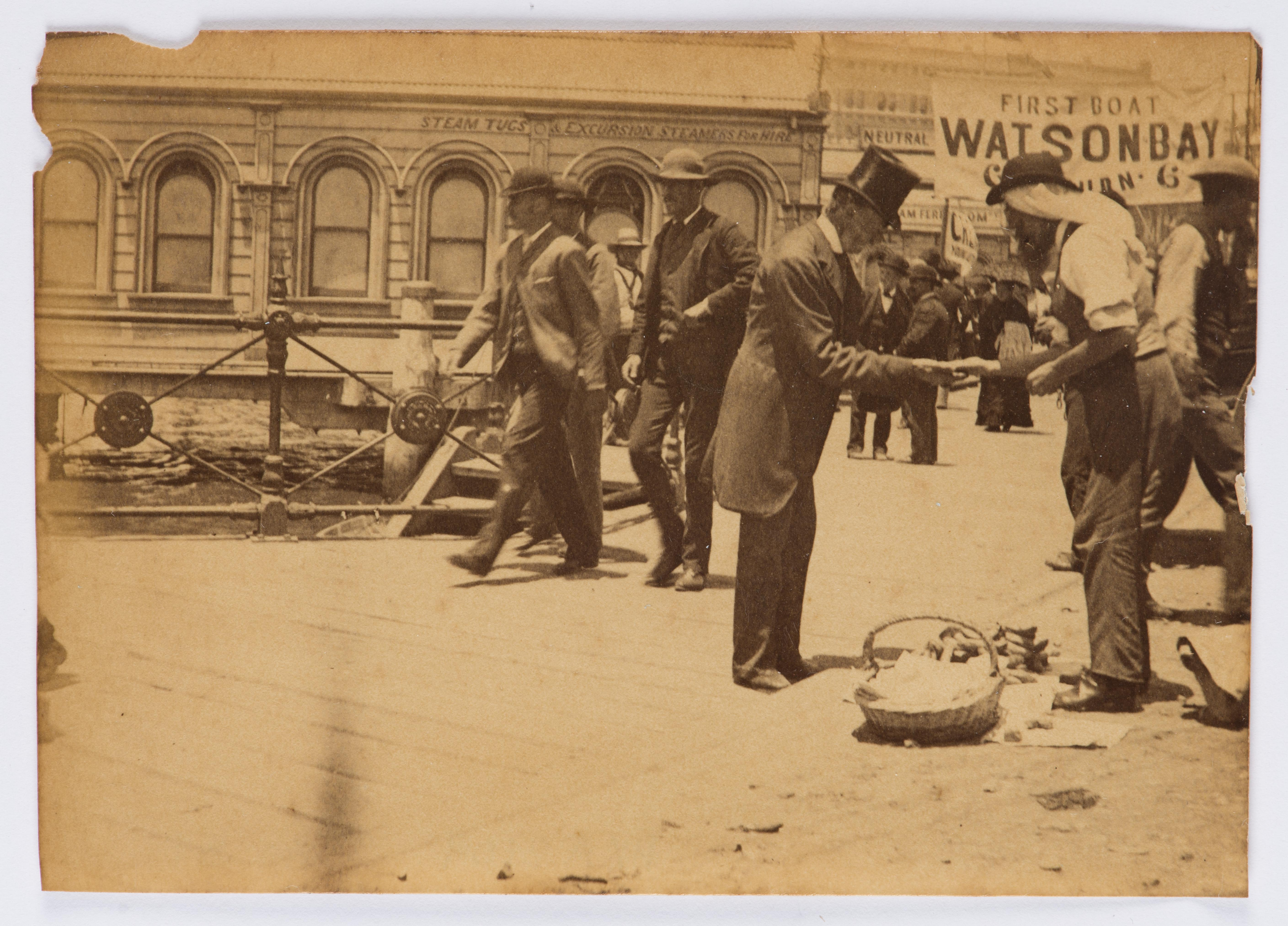 [Gentleman paying street merchant],  ca. 1880s-1900