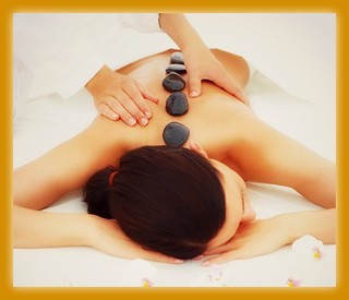 Beautiful woman receiving hotstone massage at spa | by Zenspa1