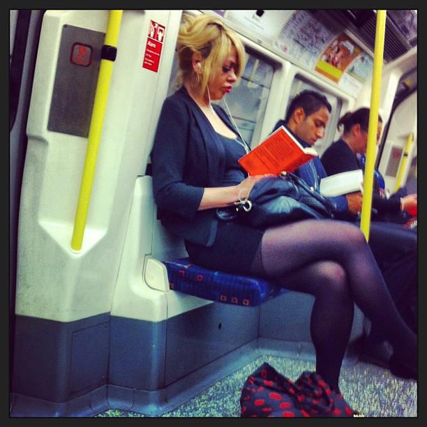 Milf reading in the Tube