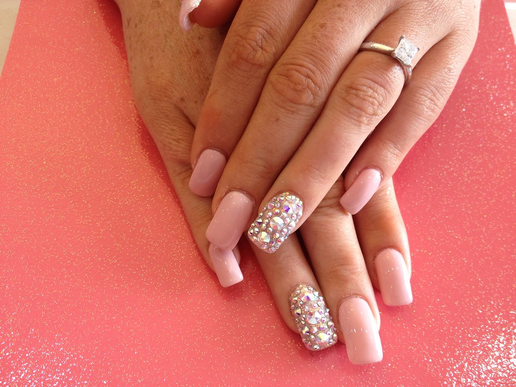 b4bcf29ef ... Acrylic nails with nude gel polish and Swarovski crystals on ring  finger | by Eye Candy