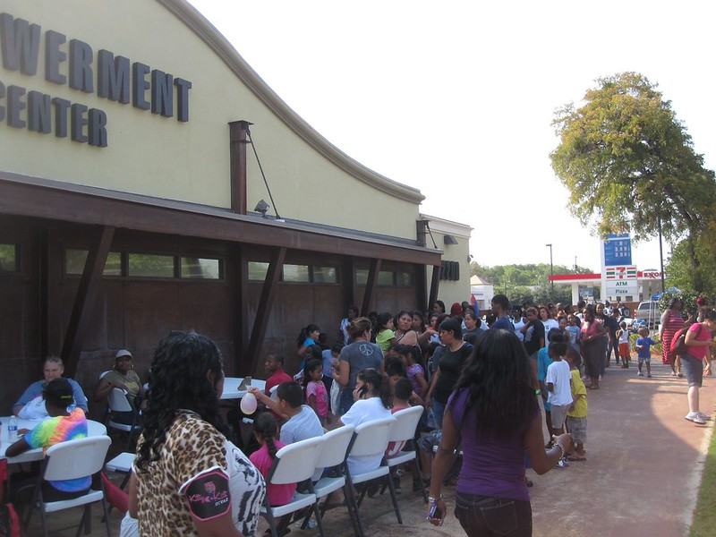 As the line snaked around the front of the Empowerment Center, organizers ensured everyone stayed hydrated and that maximum use was made of every bit of shade.