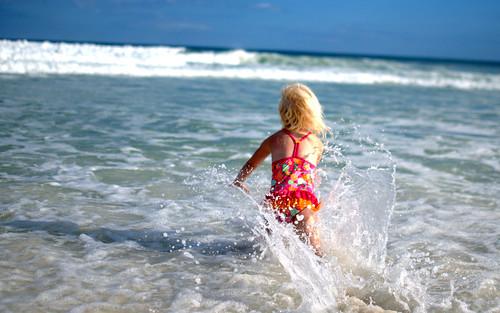 Avery Running Through the Water   by donnierayjones