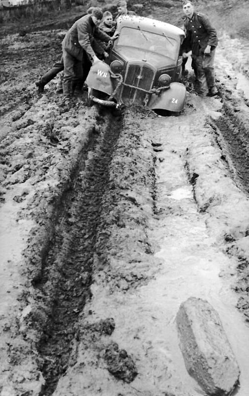German soldiers pushing car out of the mud