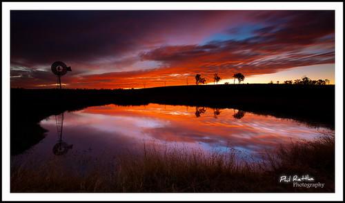 sunset sky lake reflection water windmill fire dusk dam flame qld epic ipswich
