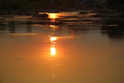 usa sun reflection water sunrise reflections river colorado rocks smoke oranges sanjuanriver watereffect southwesternus ontheriver canon28135 deeporange smokeysunrise canon5dmarkiii sunriseontheriver pagosaspringssunrise